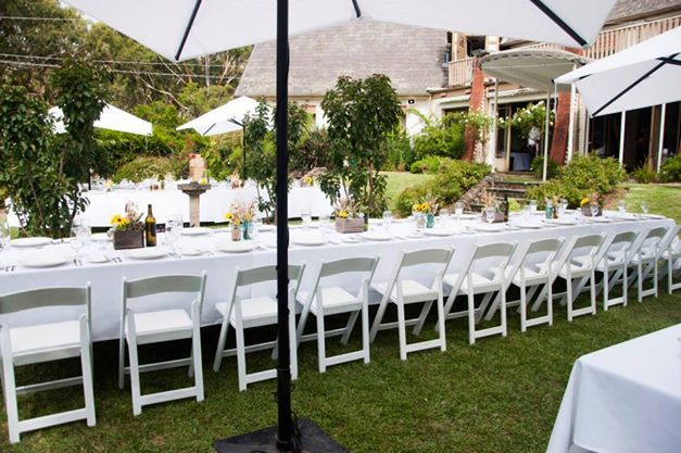 Wattle Park Chalet garden wedding reception venue market umbrella outdoor chairs